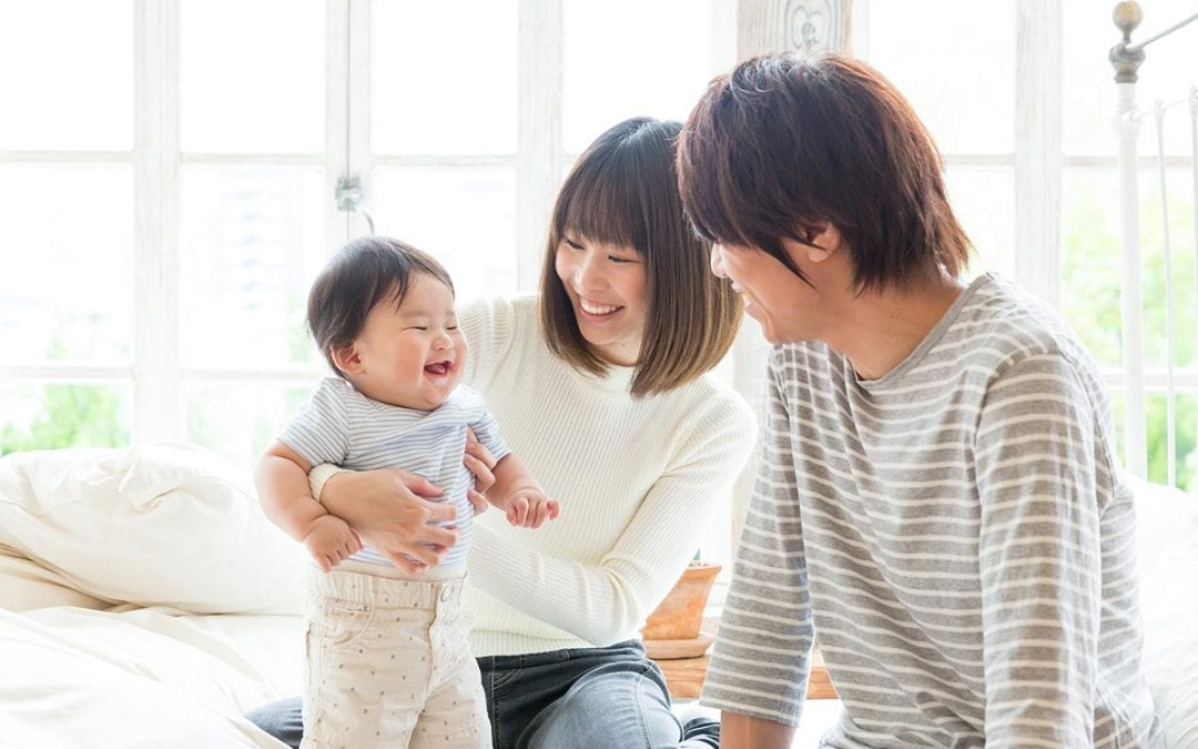 Family smiling with baby